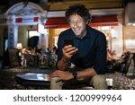 smiling mature man checking... | Shutterstock . vector #1200999964