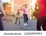 happy elementary kids playing... | Shutterstock . vector #1200999991