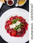 beef carpaccio with arugula ... | Shutterstock . vector #1201052167