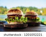 juicy tasty cheeseburger with... | Shutterstock . vector #1201052221