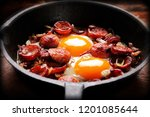 cooked egg and sausages on... | Shutterstock . vector #1201085644
