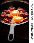 cooked egg and sausages on... | Shutterstock . vector #1201085647