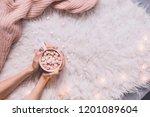cozy background. hands holding... | Shutterstock . vector #1201089604