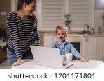 mother and daughter enjoying... | Shutterstock . vector #1201171801