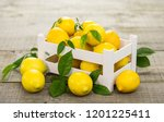 fresh lemons in the crate  | Shutterstock . vector #1201225411