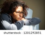 worried black woman at home... | Shutterstock . vector #1201292851