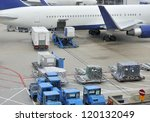 Small photo of Loading an aeroplane with airfreight at an airport