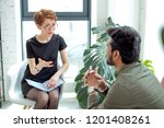 young female psychologist... | Shutterstock . vector #1201408261