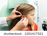 young girl at medical... | Shutterstock . vector #1201417321