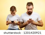 father and son are using... | Shutterstock . vector #1201420921