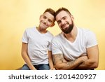 happy father and little son... | Shutterstock . vector #1201420927