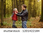 little boy with his father... | Shutterstock . vector #1201422184