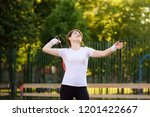young female tennis player with ... | Shutterstock . vector #1201422667