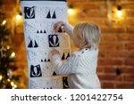 happy little boy takes sweet... | Shutterstock . vector #1201422754