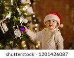 little boy wearing santa hat...   Shutterstock . vector #1201426087