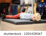 tired little boy during... | Shutterstock . vector #1201428367