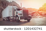 a white truck running on the... | Shutterstock . vector #1201432741