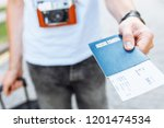 a man with a suitcase  holding... | Shutterstock . vector #1201474534