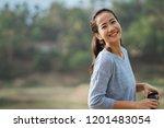 smiling happy woman looking... | Shutterstock . vector #1201483054