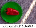 red sweet pepper on a green... | Shutterstock . vector #1201548187