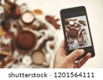hand holding phone and taking... | Shutterstock . vector #1201564111