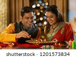 young couple decorating the... | Shutterstock . vector #1201573834