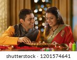 young couple decorating the... | Shutterstock . vector #1201574641