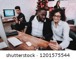 smiling managers working on new ... | Shutterstock . vector #1201575544