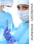 surgeon doctor in mask...   Shutterstock . vector #1201582414