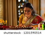 woman decorating the house with ...   Shutterstock . vector #1201590514