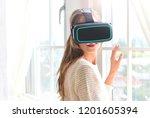 girl in vr headset near the... | Shutterstock . vector #1201605394