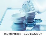 bottle with lens solution and... | Shutterstock . vector #1201622107
