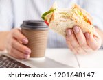 woman working and eating at...   Shutterstock . vector #1201648147