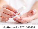 woman holding menstrual tampon...   Shutterstock . vector #1201649494
