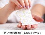 women holding a sanitary napkin   Shutterstock . vector #1201649497
