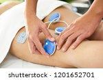 physiotherapist applying... | Shutterstock . vector #1201652701