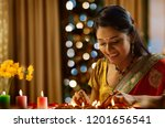 woman decorating the house with ... | Shutterstock . vector #1201656541