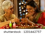 daughter in law decorating the... | Shutterstock . vector #1201662757