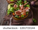 herby salad  fresh figs  baked... | Shutterstock . vector #1201723144