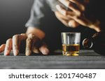 alcohol in a small glass is...   Shutterstock . vector #1201740487