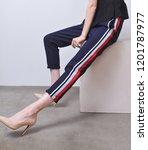 female legs in colorful stripy... | Shutterstock . vector #1201787977