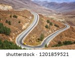 yellow car driving on mountain...   Shutterstock . vector #1201859521