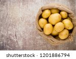 sack of fresh raw potatoes on... | Shutterstock . vector #1201886794