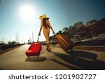 beautiful woman carrying... | Shutterstock . vector #1201902727