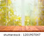 wood table and window with... | Shutterstock . vector #1201907047