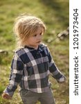 baby boy with blond hair in... | Shutterstock . vector #1201973404