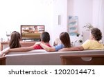 family watching tv at home | Shutterstock . vector #1202014471
