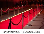 long red carpet between rope... | Shutterstock . vector #1202016181