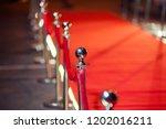 long red carpet between rope... | Shutterstock . vector #1202016211