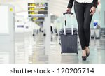 young woman pulling luggage at... | Shutterstock . vector #120205714